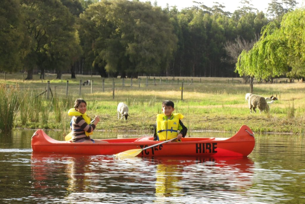Farm Activities for Kids Canoeing in the dam